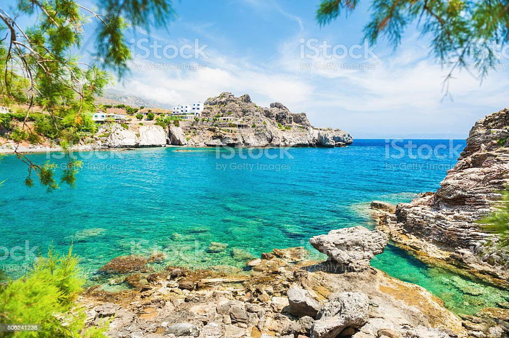 Beautiful beach with turquoise water and cliffs. stock photo