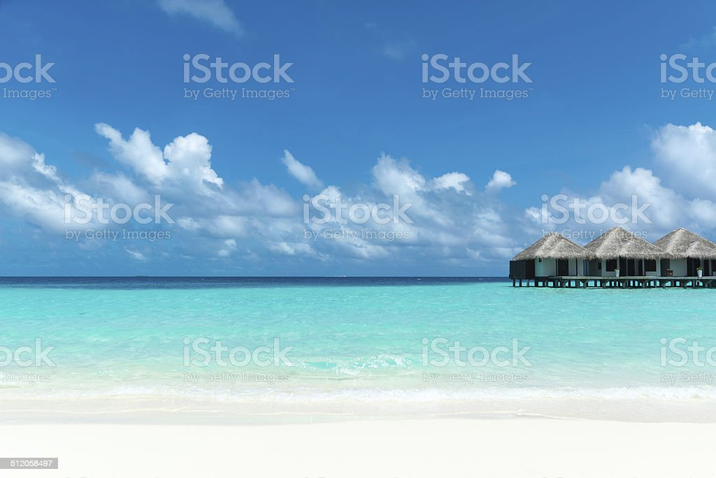 Beautiful beach with water bungalows at Maldives stock photo
