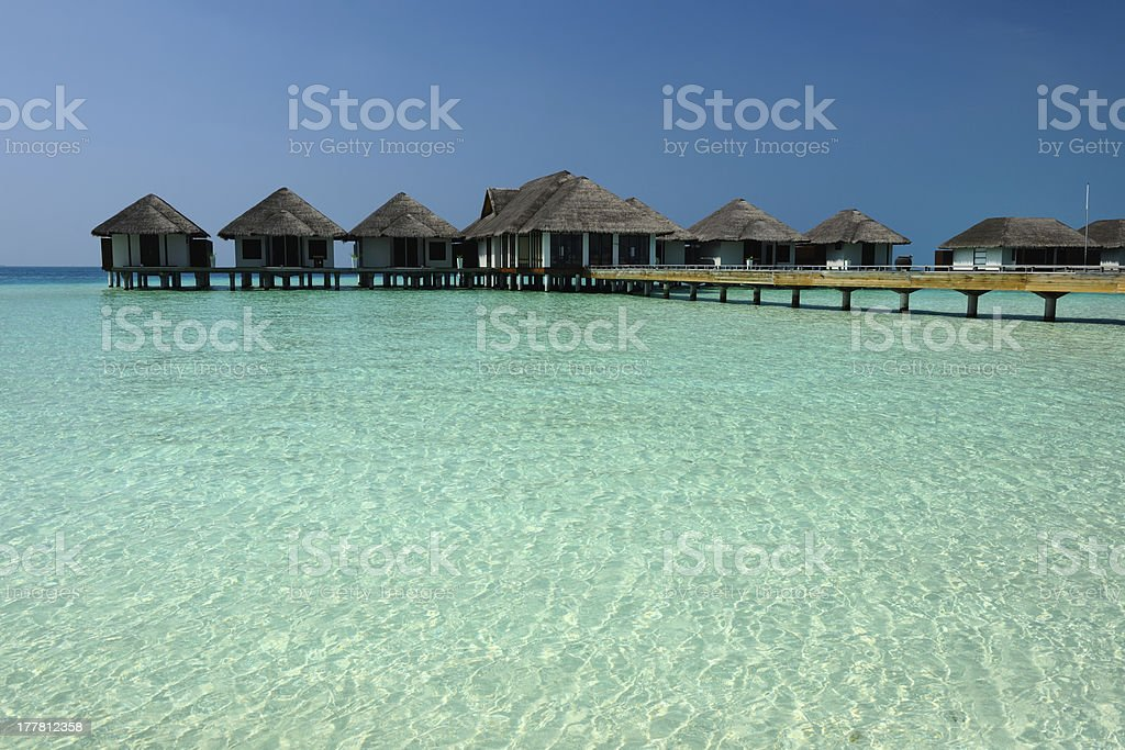 Beautiful beach with water bungalows royalty-free stock photo