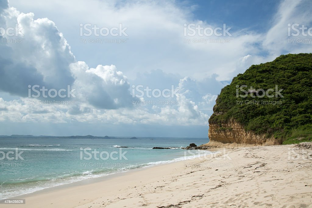 Beautiful beach with white sand beach and clouds stock photo