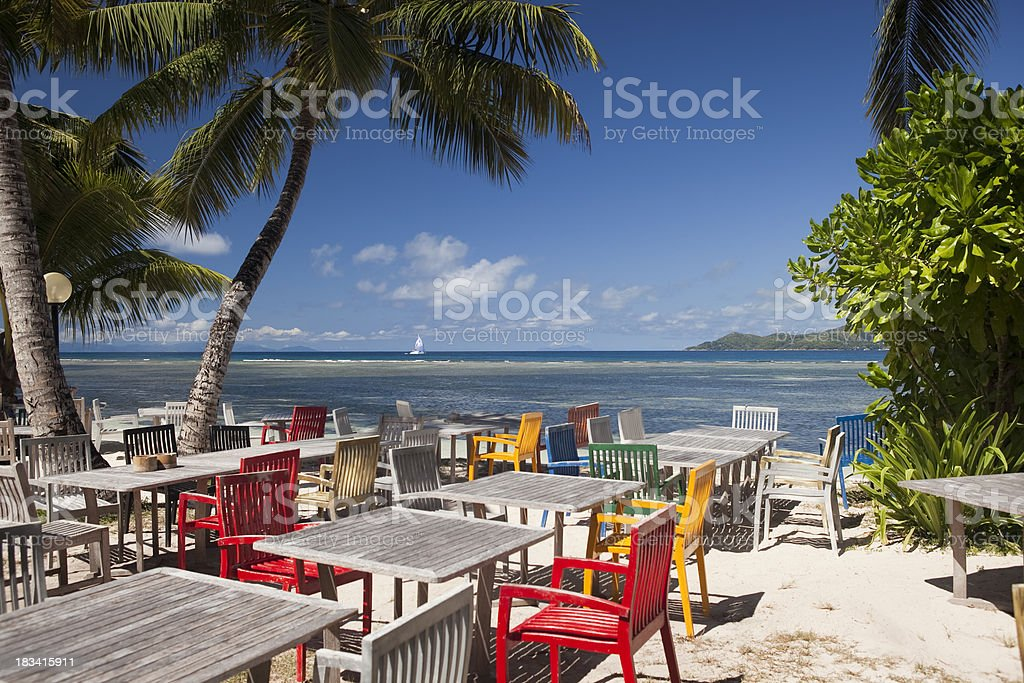 Beautiful beachfront restaurant with palm trees stock photo