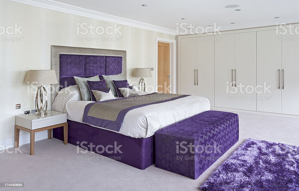 beautiful bed in purple stock photo