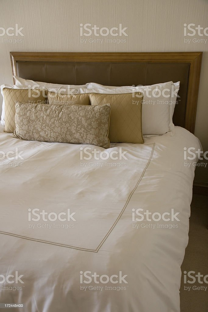 Beautiful bed spread with pillows royalty-free stock photo