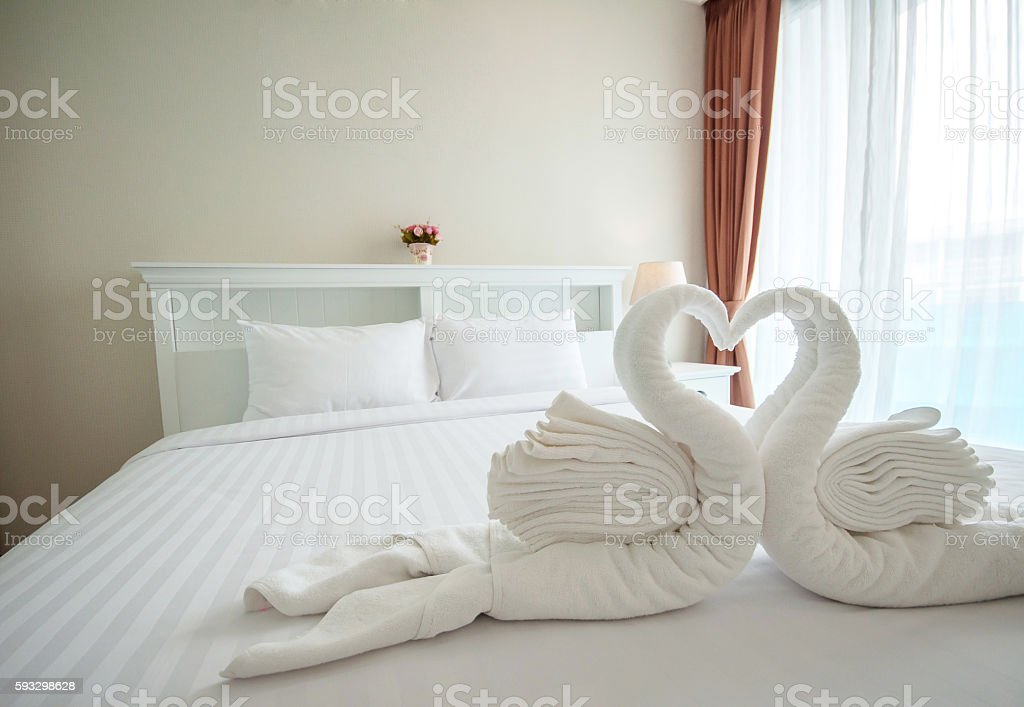 Beautiful bedroom interior and towels stock photo