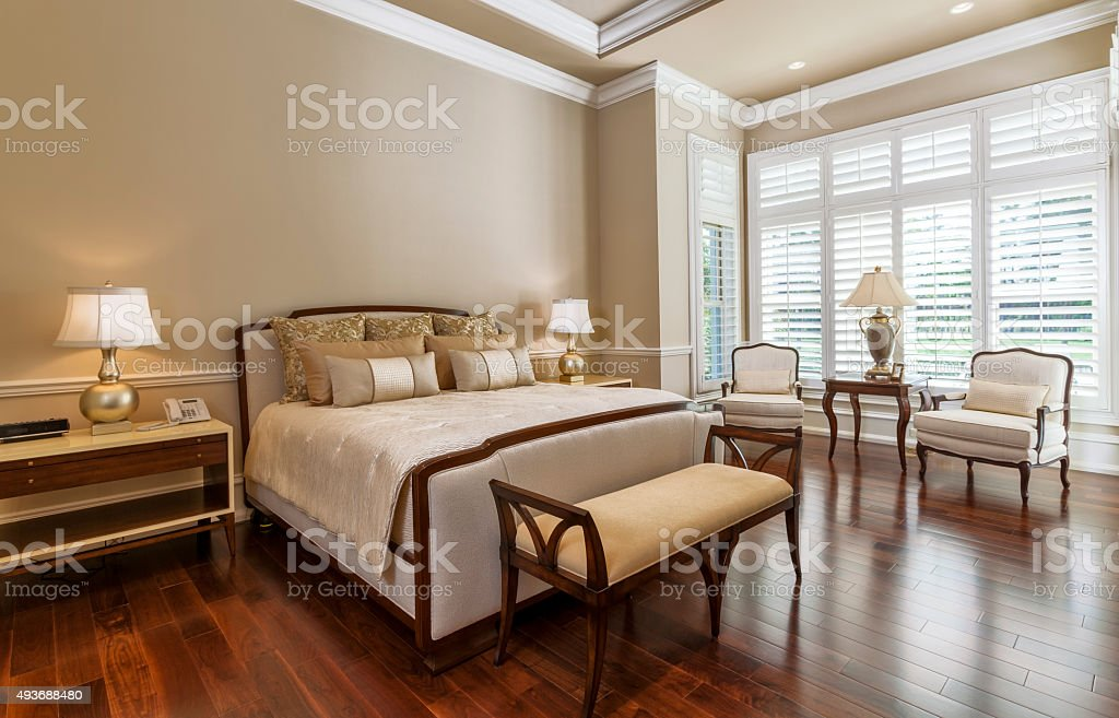 Beautiful Bedroom Suite with Sitting Area at Estate Home stock photo