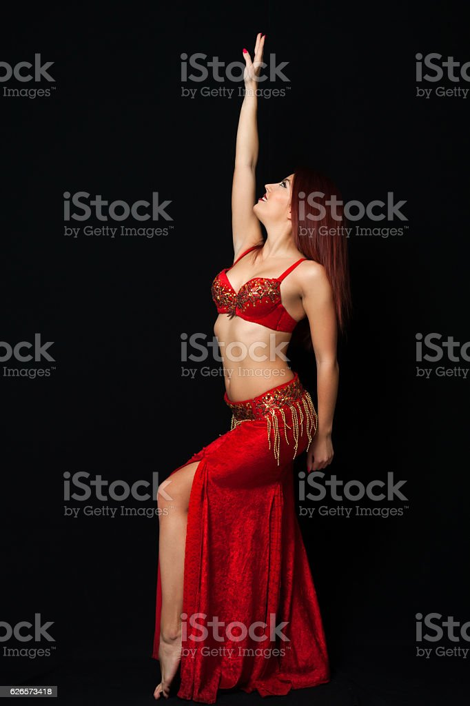 Beautiful belly dancer performing exotic dance stock photo