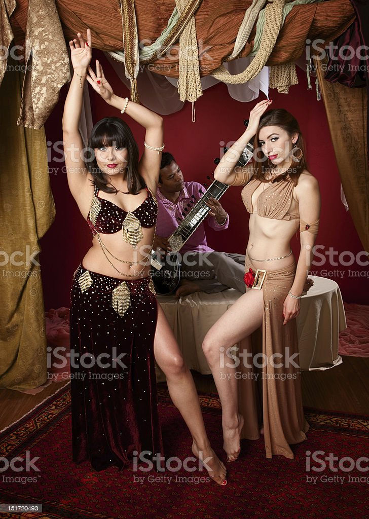 Beautiful Belly Dancers With Indian Man Playing a Sitar stock photo
