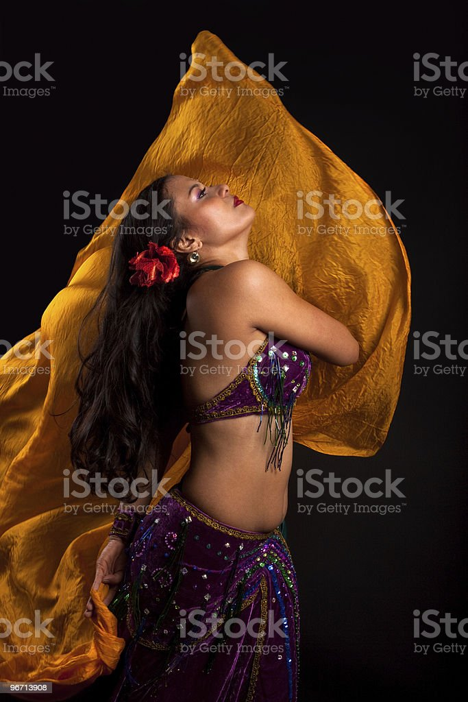 Beautiful bellydancer tossing veil royalty-free stock photo