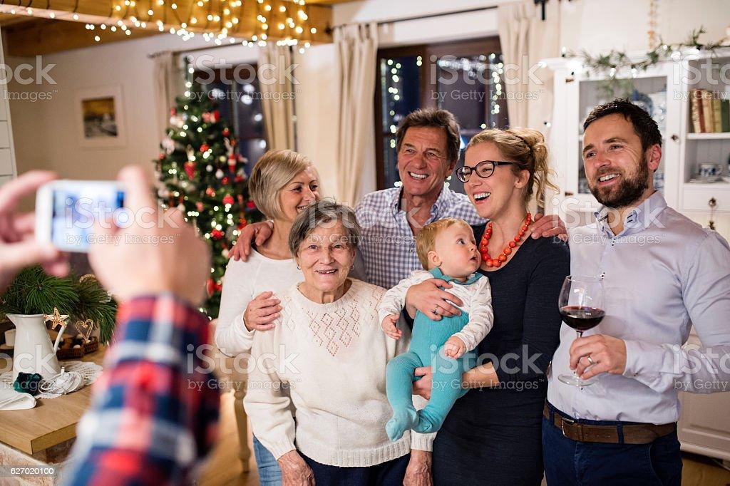 Beautiful big family celebrating Christmat together being photog stock photo