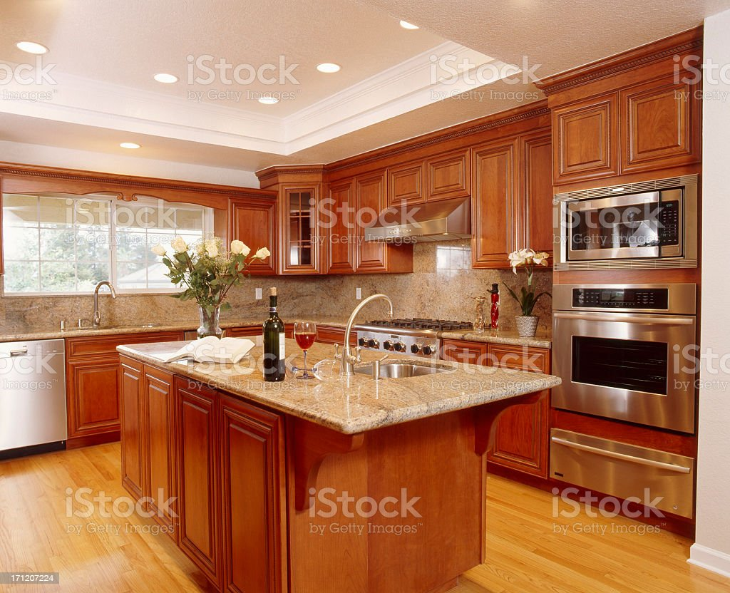 Beautiful big kitchen with island and wooden cupboards stock photo
