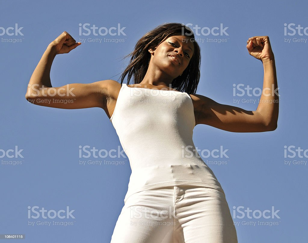 Beautiful Black Girl Flexing Her Muscles royalty-free stock photo
