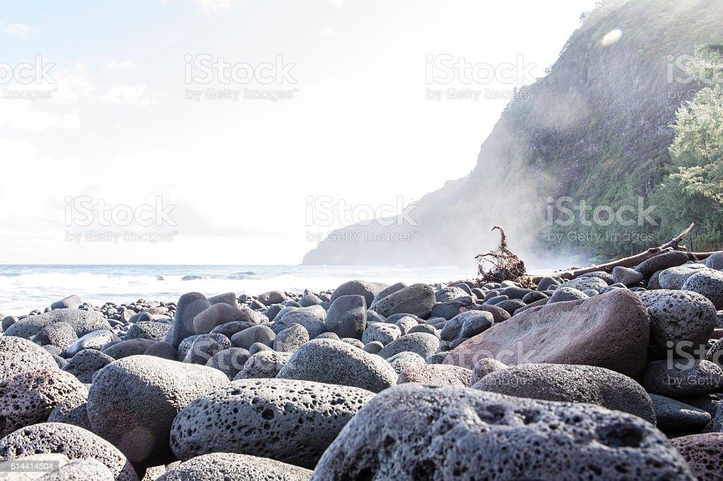beautiful black stone beach - waipio valley, hawaii stock photo