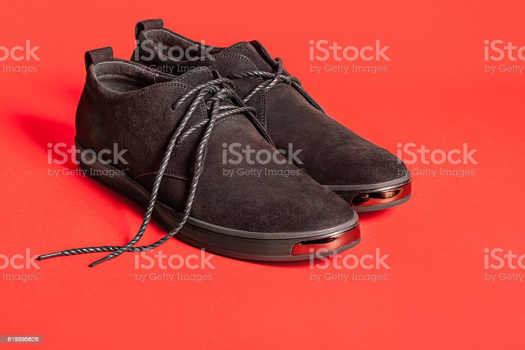 Beautiful black suede shoes. stock photo