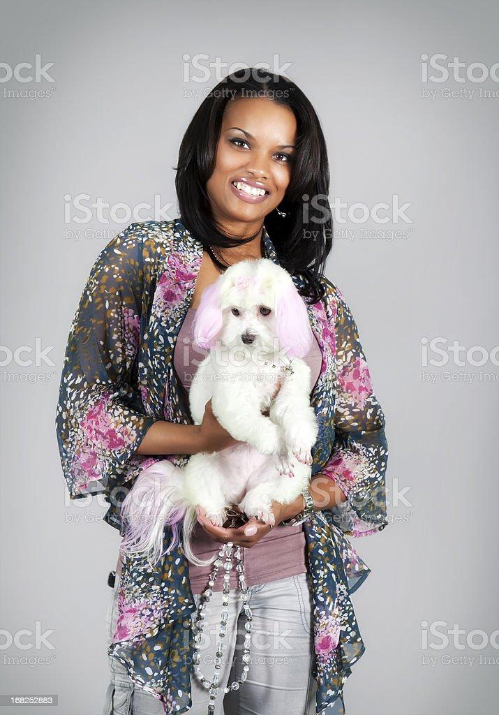 Beautiful black woman and pink dog royalty-free stock photo