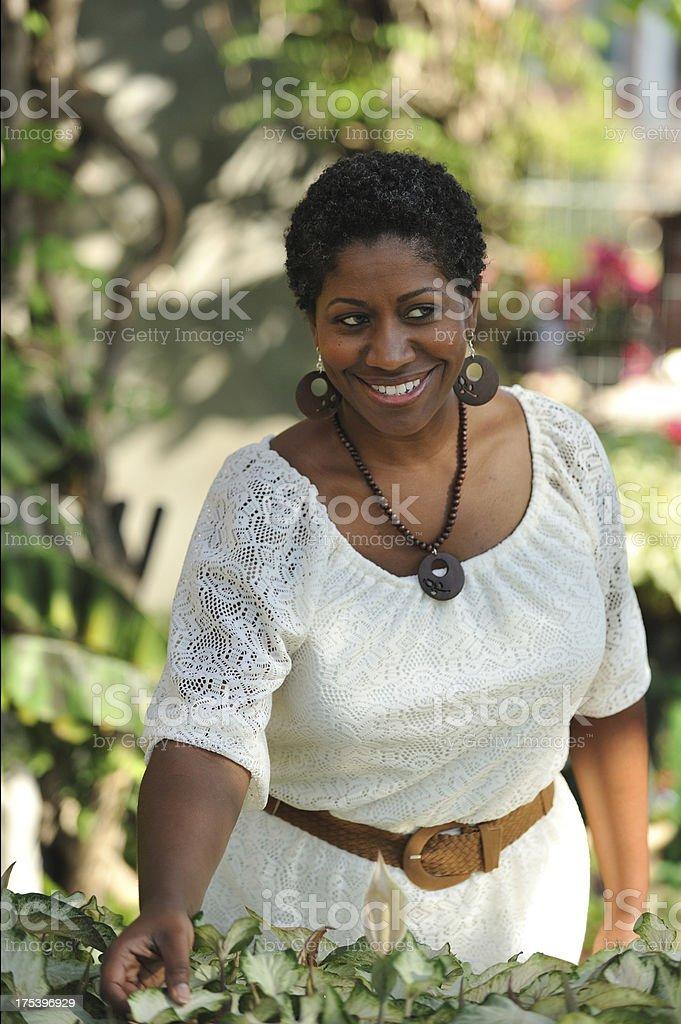 Beautiful black woman in the garden royalty-free stock photo