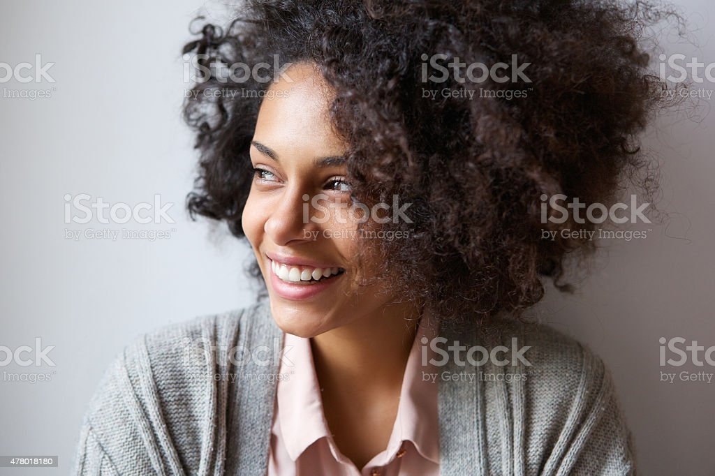 Beautiful black woman smiling and looking away stock photo