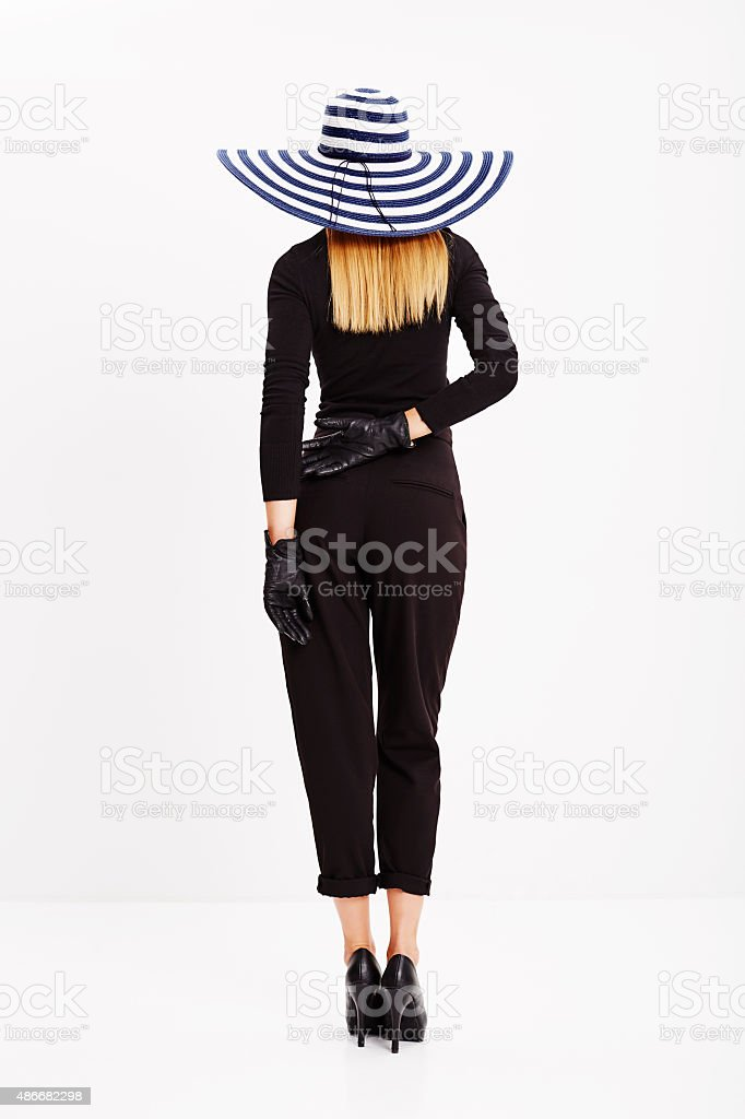 Beautiful blond back in black stock photo