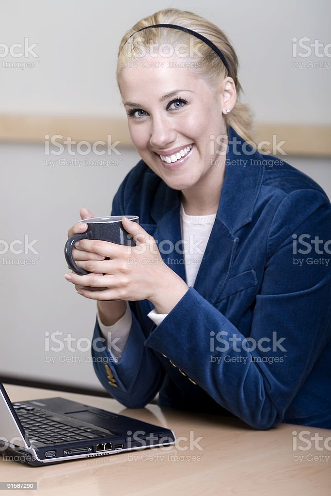 Beautiful Blond Businesswoman Portrait, Using Laptop in Office Conference Room royalty-free stock photo