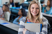 Beautiful blond college student in classroom