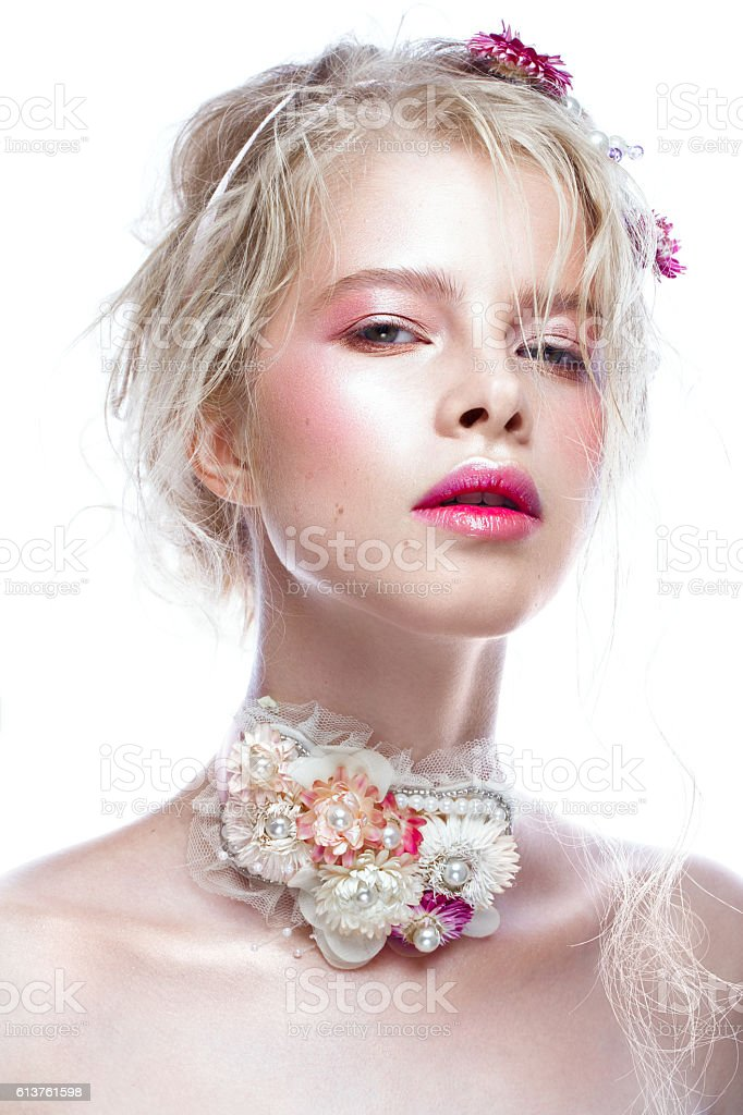 Beautiful blond fashion girl with flowers on neck and in stock photo
