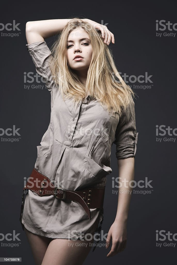 Beautiful blond fashion model with blowing hair royalty-free stock photo