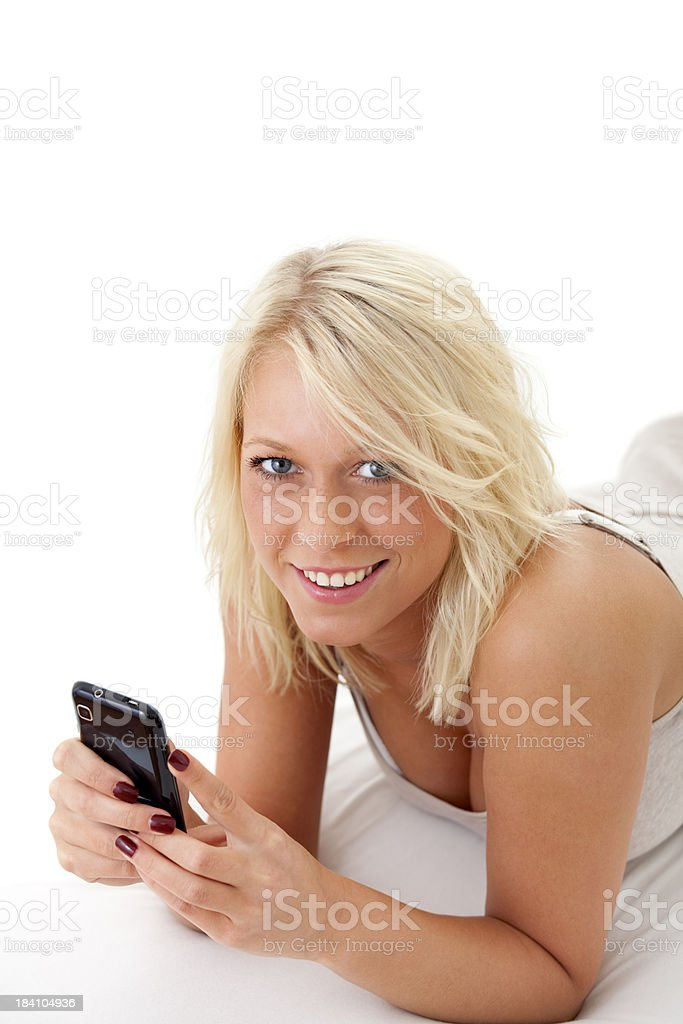 Beautiful blond female teenager with smartphone royalty-free stock photo
