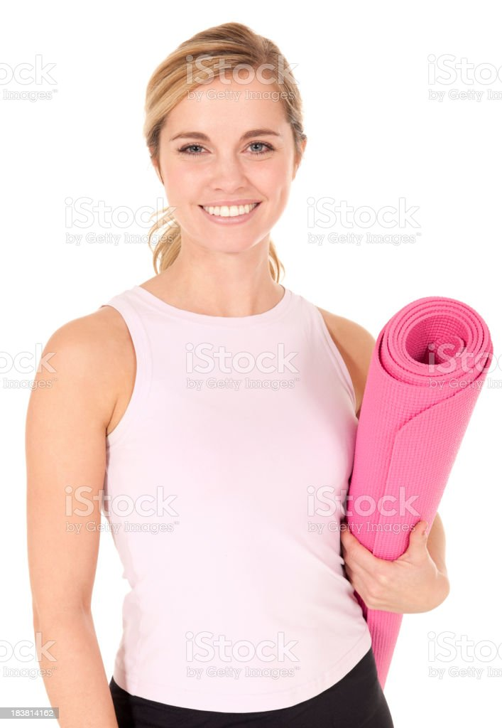 Beautiful blond female with pink yoga mat smiling bright stock photo