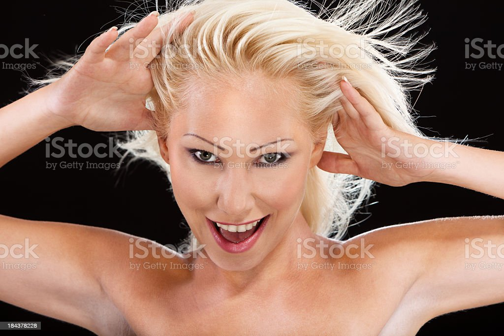 Beautiful Blond Girl Dancing Against Black Background royalty-free stock photo