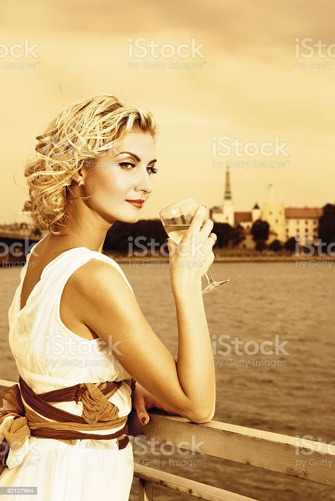 Beautiful blond girl drinks champagne royalty-free stock photo