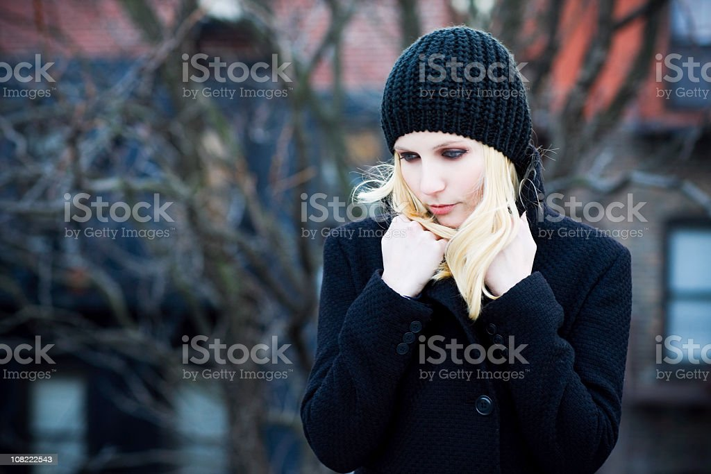 Beautiful Blond Young Woman Portrait Looking Sad on Cold Day royalty-free stock photo