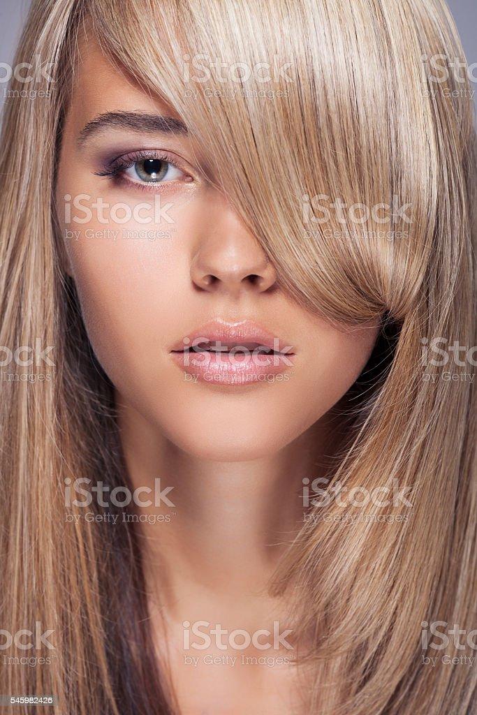 Beautiful Blond Girl. Healthy Long Hair. stock photo
