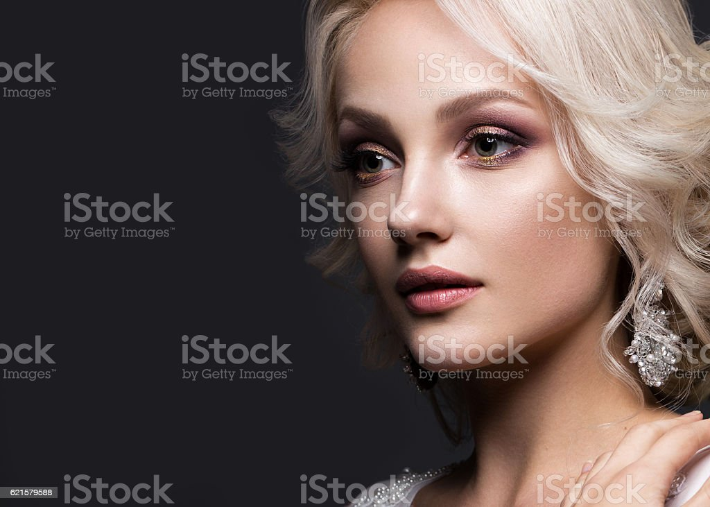 beautiful blond girl in image of the bride with wedding stock photo