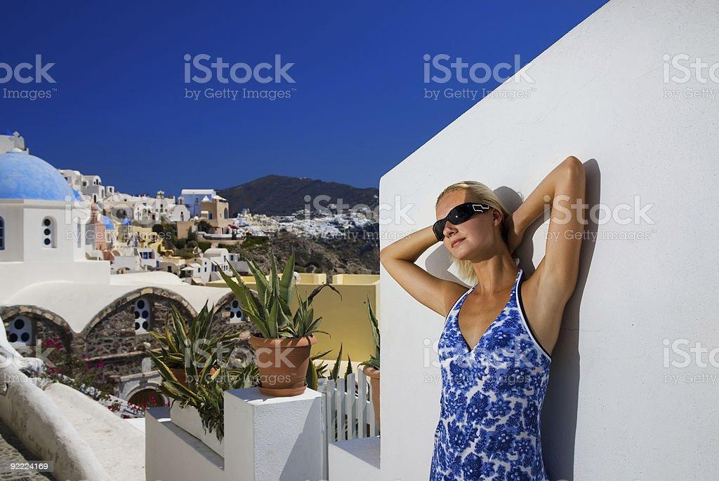 Beautiful blond girl on Santorini Island (Greece) royalty-free stock photo