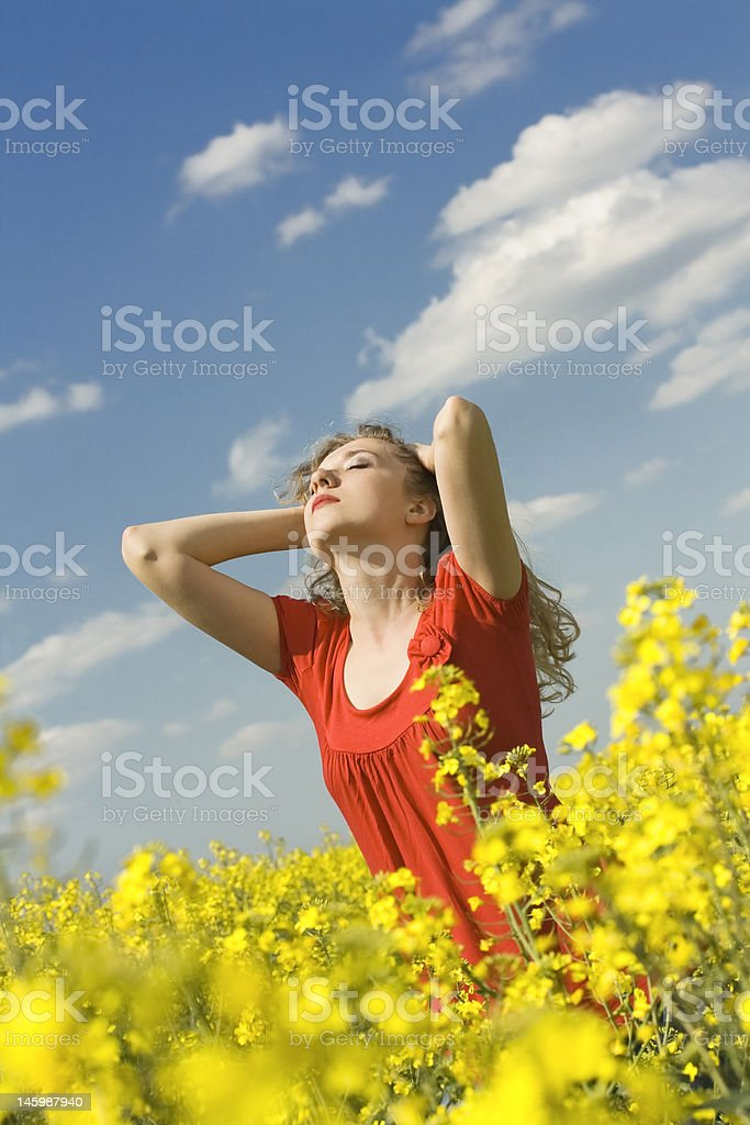 beautiful blond girl relaxing in a field royalty-free stock photo