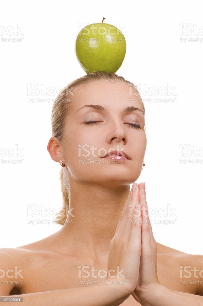 Beautiful blond girl with a green apple on her head royalty-free stock photo