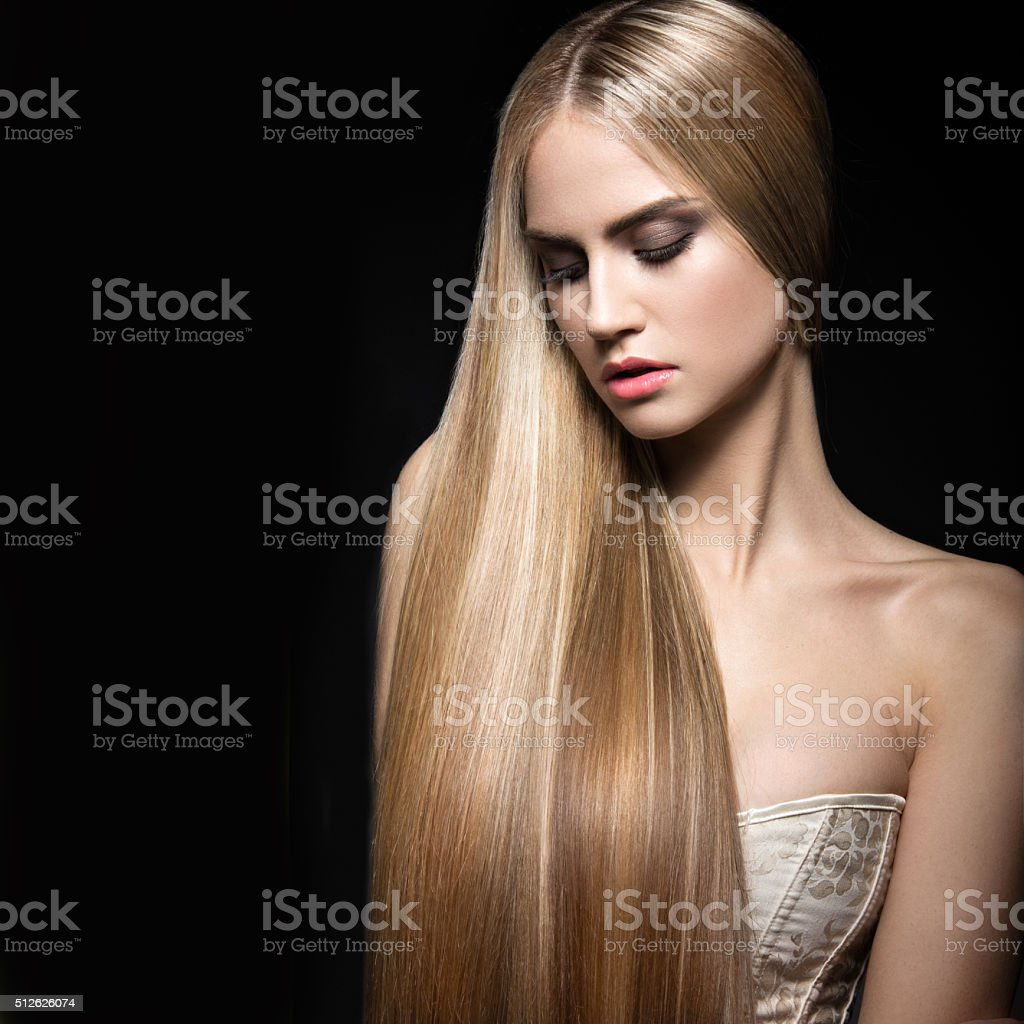 Beautiful blond girl with perfectly smooth hair and classic make-up. stock photo
