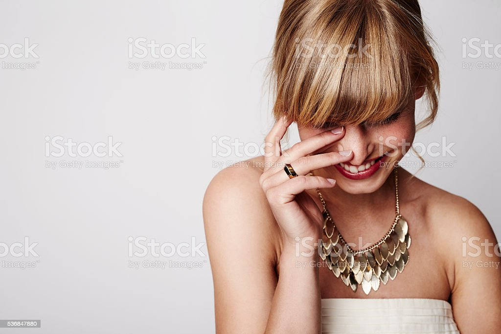 Beautiful blond laughing with gold necklace, close up stock photo