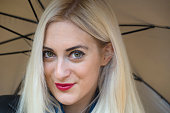 Beautiful blond pale big green eye girl close up portrait