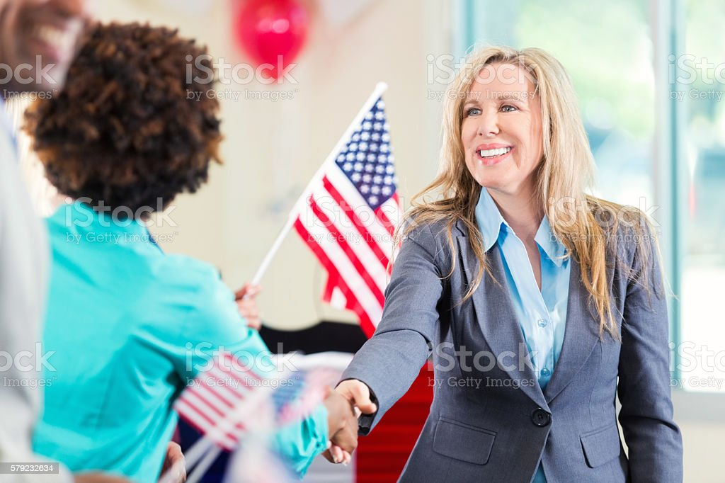 Beautiful Blond Politician shaking hands stock photo