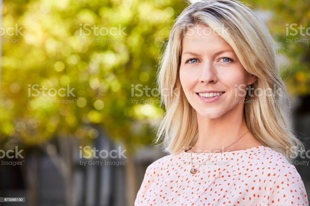 Beautiful blond smiling stock photo