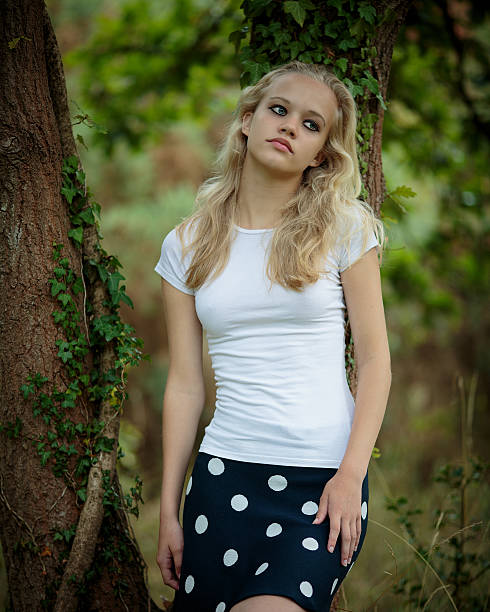 Beautiful Blond Teenage Girl Outside In The Woods Stock