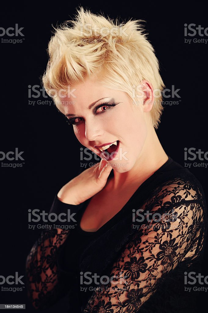 Beautiful Blond With Fangs royalty-free stock photo