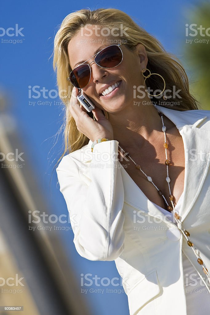 Beautiful Blond Woman Businesswoman On Her Cell Phone royalty-free stock photo