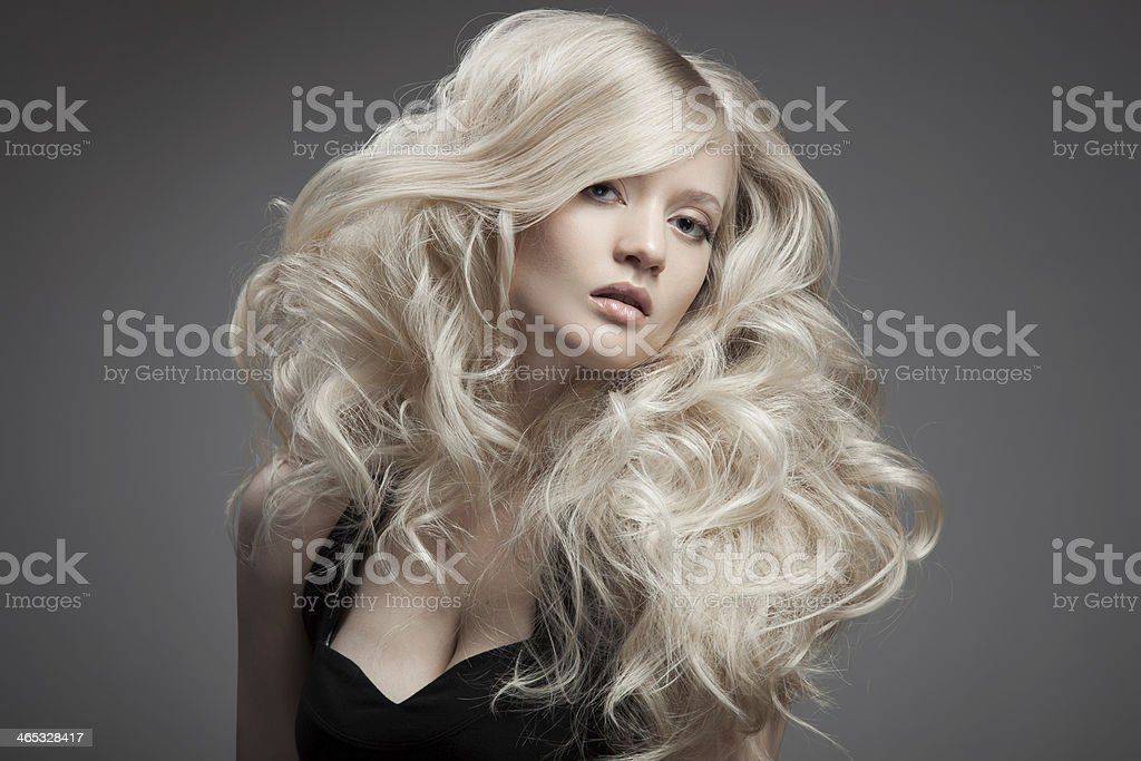Beautiful Blond Woman. Curly Long Hair stock photo