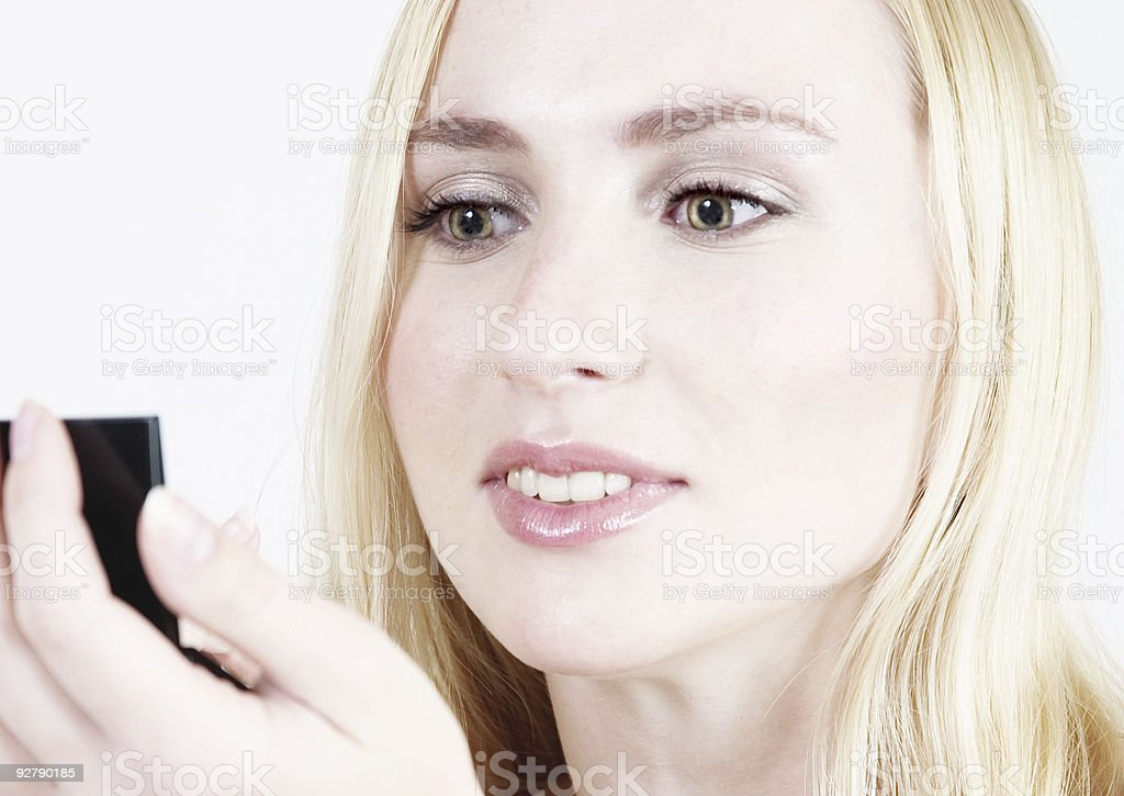 beautiful blond woman doing make-up royalty-free stock photo
