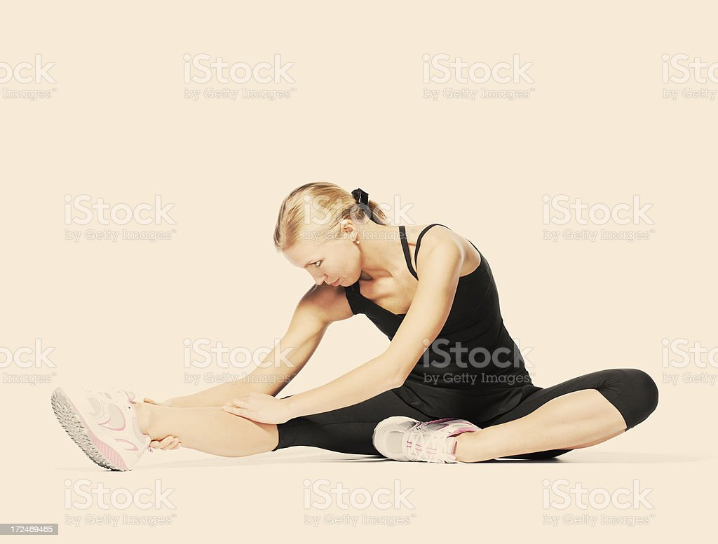 beautiful blond woman doing stretching sports exercises. royalty-free stock photo