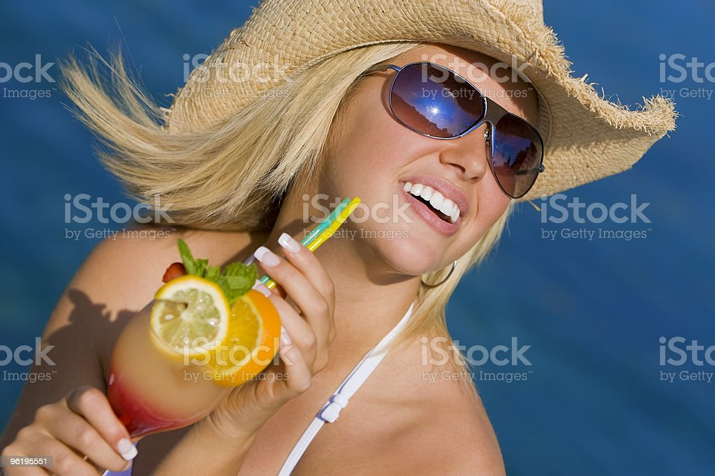 Beautiful Blond Woman Drinking Cocktail By The Sea royalty-free stock photo