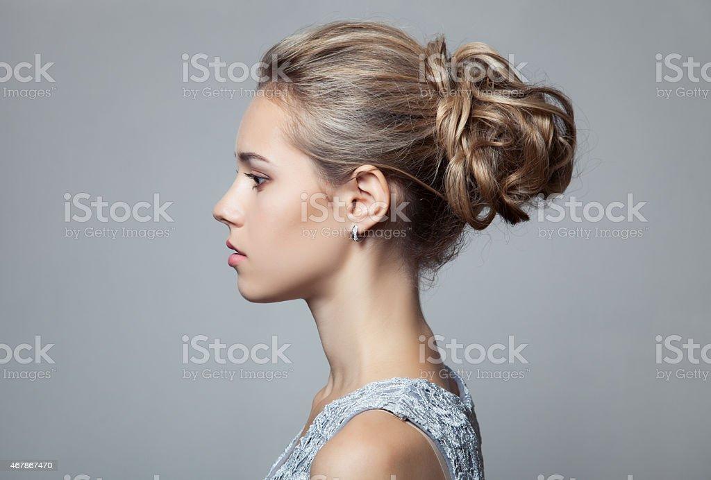 Beautiful Blond Woman. Hairstyle and Make-up. stock photo