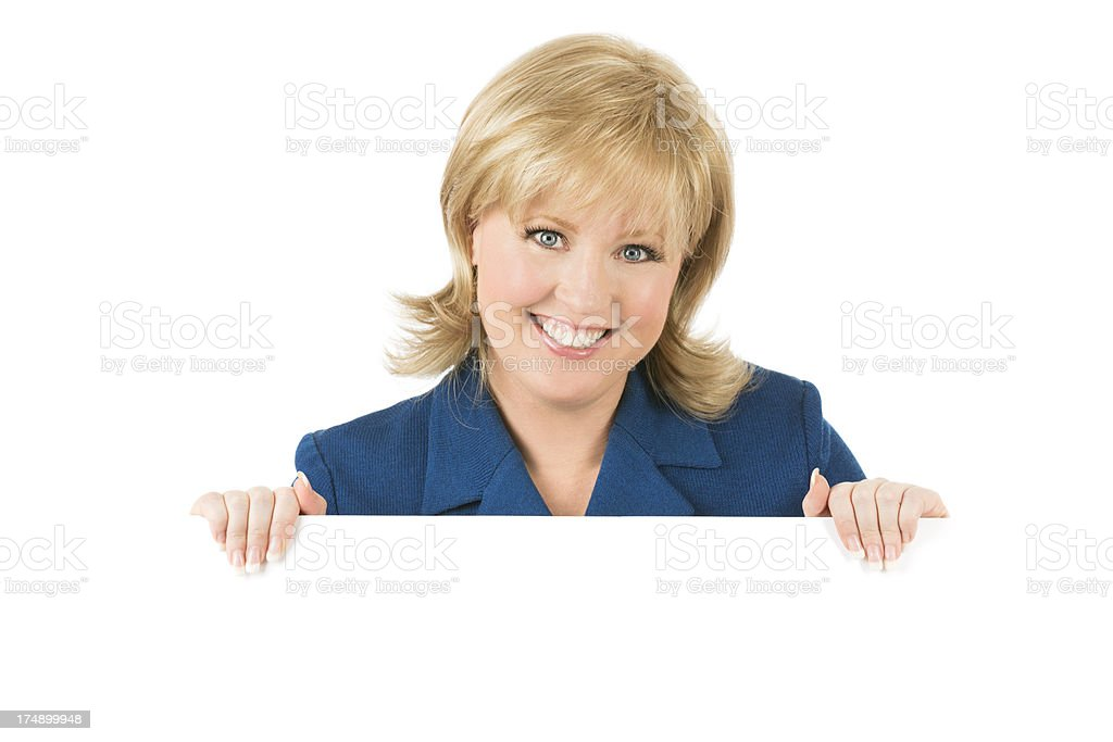 Beautiful blond woman holding a blank sign royalty-free stock photo