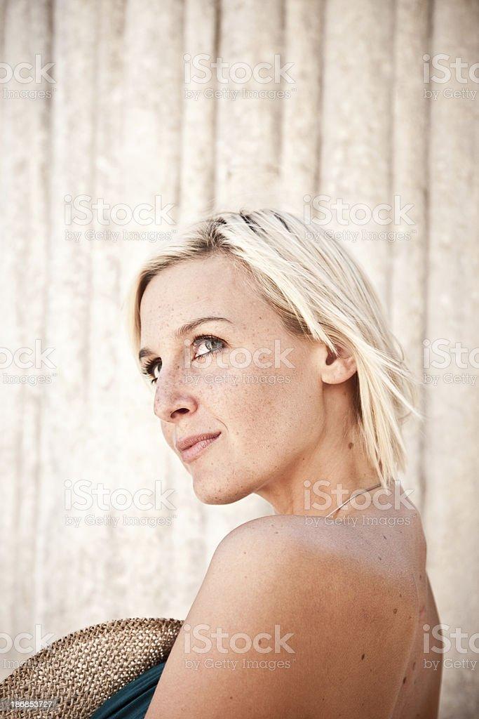 Beautiful Blond Woman Holding Panama Hat royalty-free stock photo